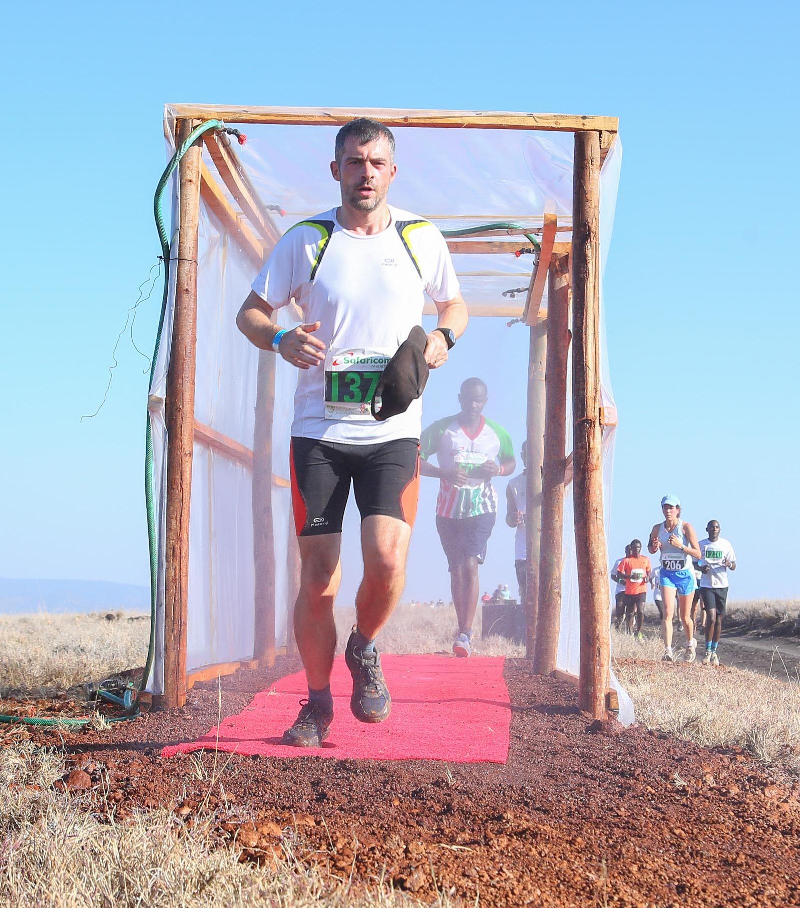 Thibaud running in the wild during the 2017 Safaricom Marathon in Lewa.