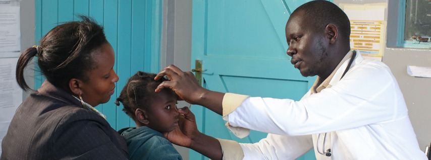 Dr John Koech attending to a patient at the West Maternity Centre in Eldoret.