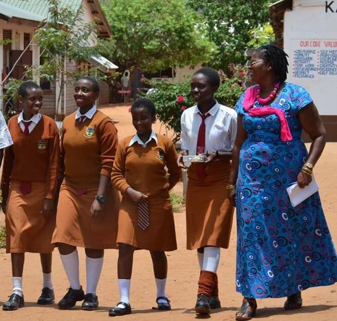 The students with school principal Phidilia Kilimo.