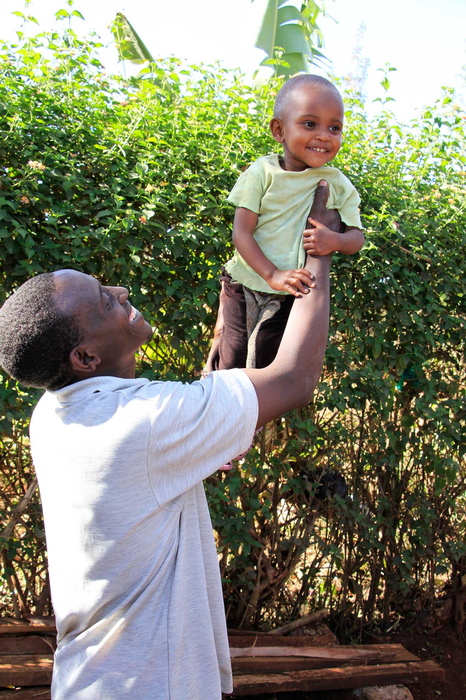 Angel with her father John Kiruga at their home in Gatundu.