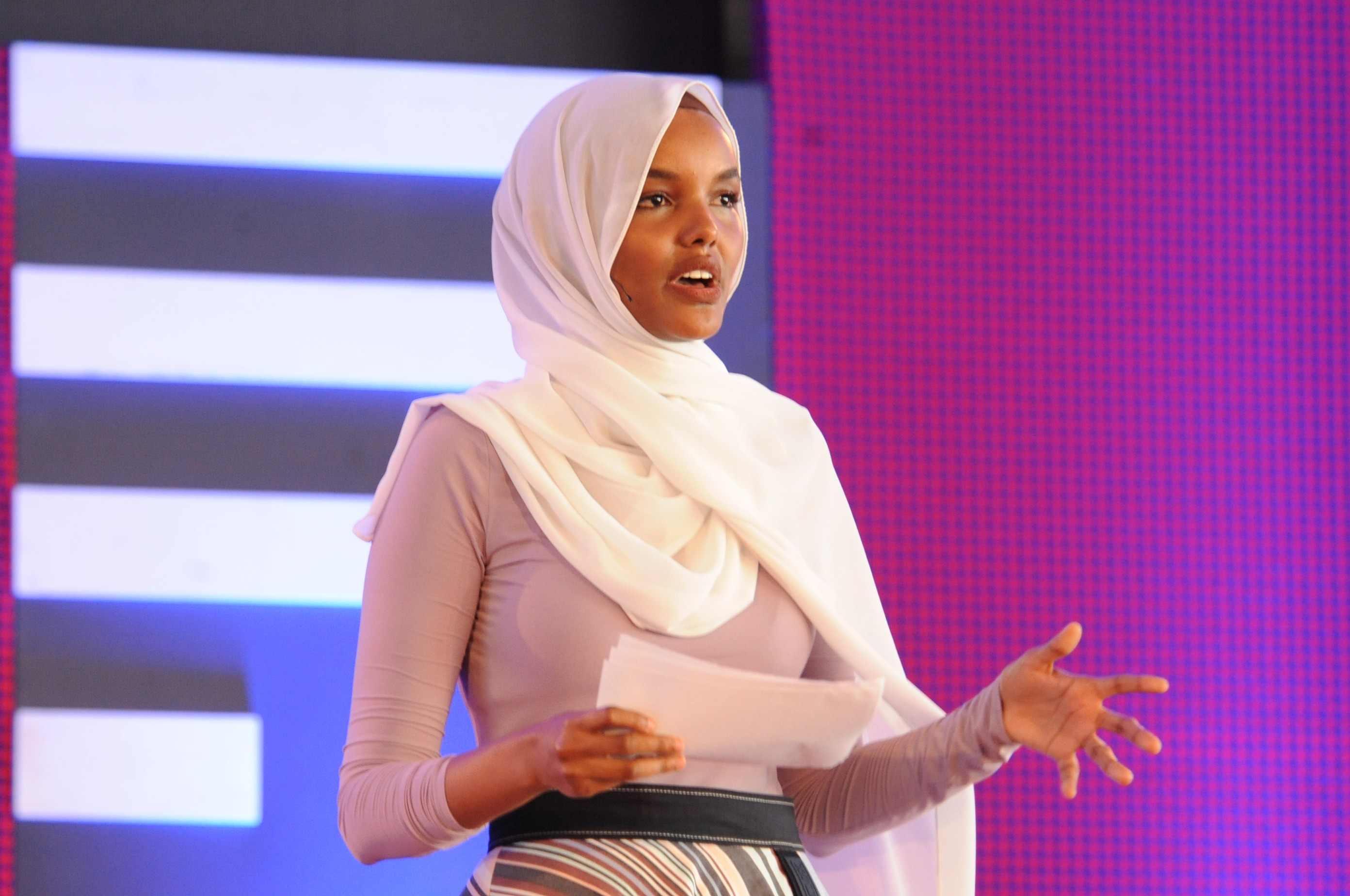 Halima Aden, a UNICEF Goodwill Ambassador, addressing the audience at the Kakuma Refugee Camp during the TEDx event.