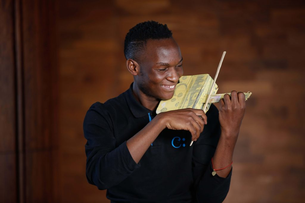 Stephen Ongoma is a Safaricom Youth Orchestra graduate and teaches weekly box violin classes to four children.